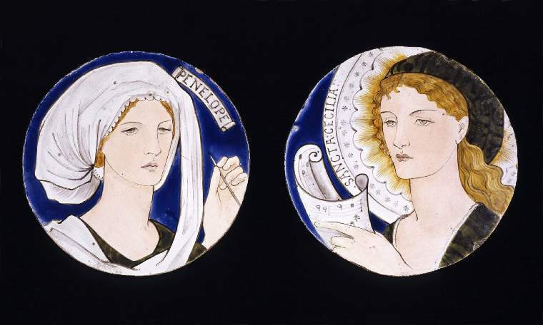 An image of Art Pottery. Tile. Sancta Cecilia. Burne-Jones, Edward (British, 1833-1898). Morris, Marshall, Faulkner & Co. Faulkner, Kate, painter (British, 1842-1898). A head and shoulders painted portrait of a woman, drawn in black, set on a deep blue ground. Her long, wavy, blonde hair is tucked behind her ear and she wears a green cap and gown. She holds a scroll of music in her right hand. Around her head is an elaborate halo, inscribed 'SANCTA CECILIA'. The glaze is dull, the sides of the tile are unglazed and the back is flat and rough. Cut down 6 inch tile. Buff earthenware, slip-coated, glazed and painted in blue, yellow, sage green, flesh-pink and black enamel colours, diameter 15.2 cm, circa 1865. Arts and Crafts. Notes: Saint Cecilia is the patron saint of musicians and Church music.