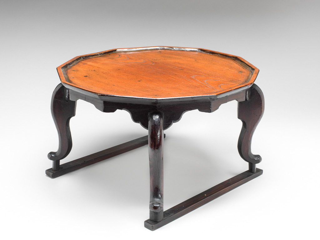 An image of Furniture. Offering table of dark brown lacquered wood, lobed shaped. Korean, age uncertain, possibly late 19th century to early 20th century. Wood, dark brown, lacquer, 1870-1930.