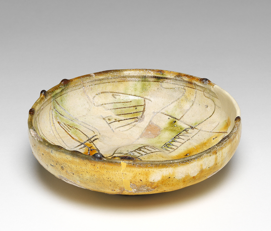 An image of Bowl. Unknown maker, Cyprus. Earthenware, coated with white slip. With decoration scratched through it under a polychrome coloured glaze, 1400-1599.