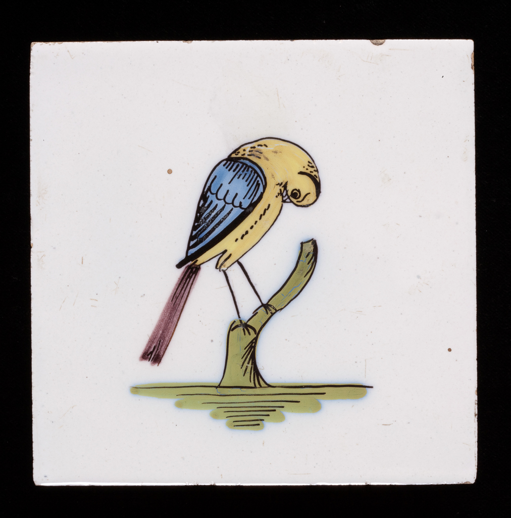 An image of English Delftware. Tile. Unidentified Liverpool pottery. A bird perching on a tree stump. Buff, fine-grained earthenware, tin-glazed white on the upper surface and painted in blue, green, yellow and manganese high-temperature colours. Height, whole, 12.6 cm, width, whole, 12.6 cm, depth, whole, 0.6 cm, circa 1750-1775. Rococo.