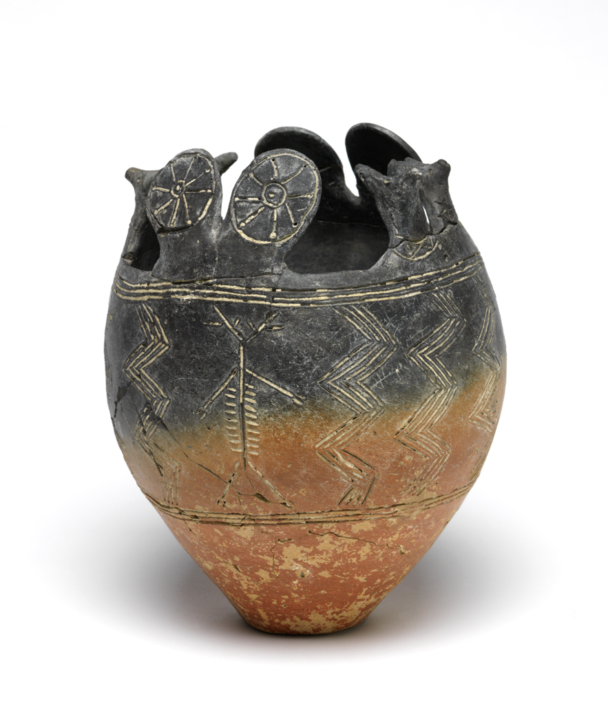 An image of Vessel/Pot. Tulip shaped ritual vessel. Red-polished ware bowl, with animal-head and sun disc attachments. Production Place: Cyprus. Find Spot: Vounous Cyprus; Tomb 91. Clay, depth, 0.15 m, width 0.174 m, height 0.172 m, 2400- 2201 B.C. Early Cypriot I. Bronze Age.