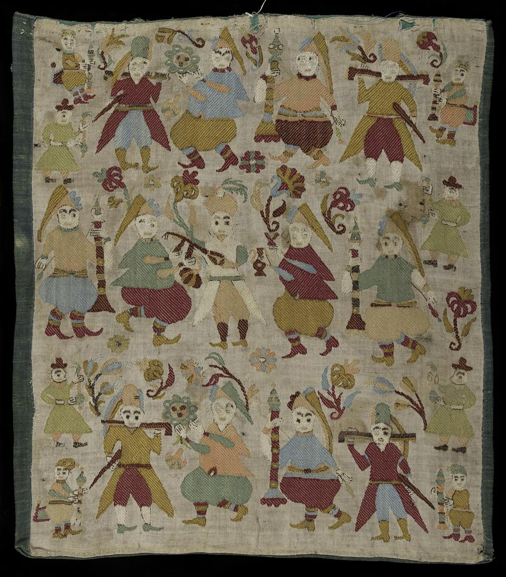 An image of Embroidery / Cushion Cover. Unknown Maker. Linen cushion cover embroidered with polychrome silks in darning, back and satin stitch. The male figures, whether part of the three dominant rows or as smaller scale motifs at each end, carry large candles, flowers, ewers, muskets or swords and possibly a mandolin. There are two distinct dress styles, long coat and breeches or short coat and baggy breeches; heads are variously covered with long caps, turbans or hats. Length 43.5 cm, width 36.5 cm, circa 1701-1801. Skyros, Northern Sporades, Greece.