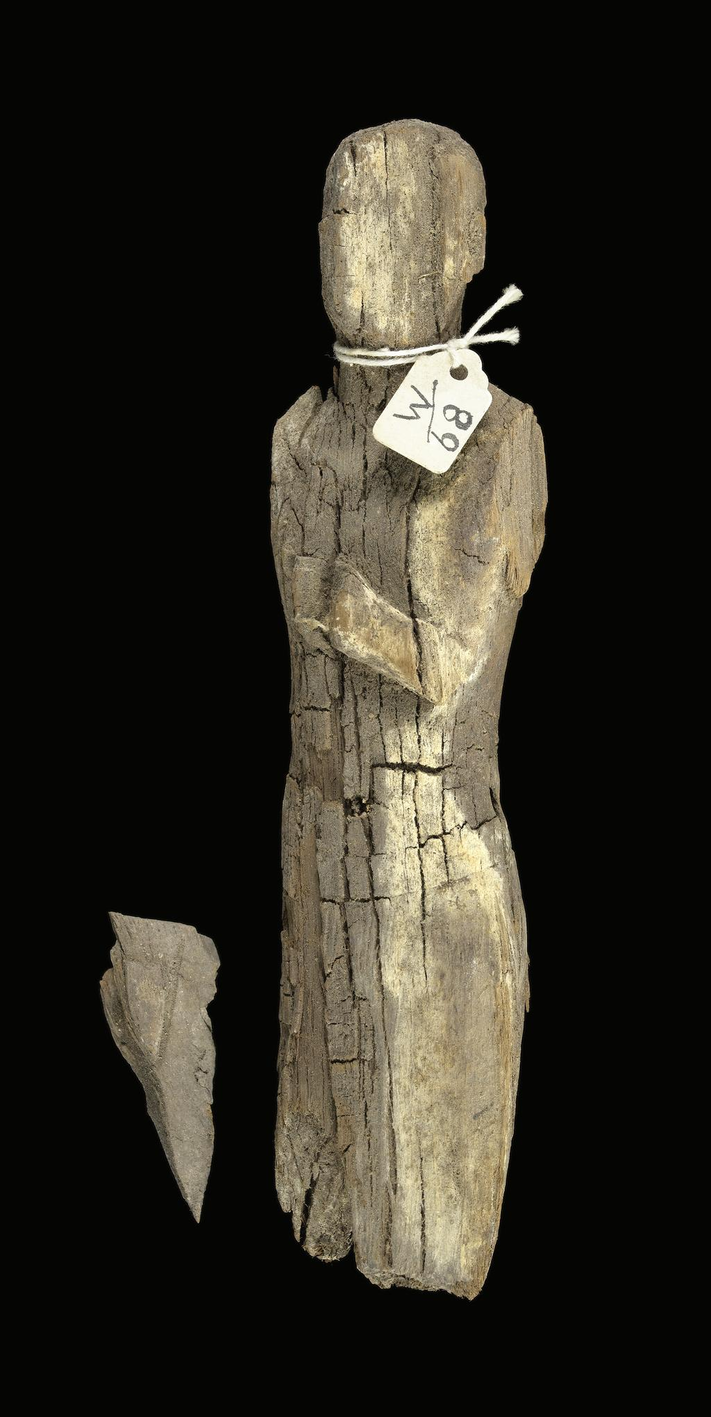 An image of Statuette. Male (?) figure, standing, poor condition. Production Place: Egypt. Wood, height 0.18 m.